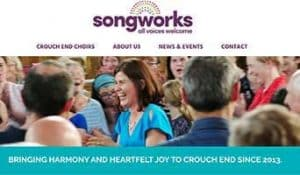 Songworks Choir homepage showing a choir leader laughing among her choir